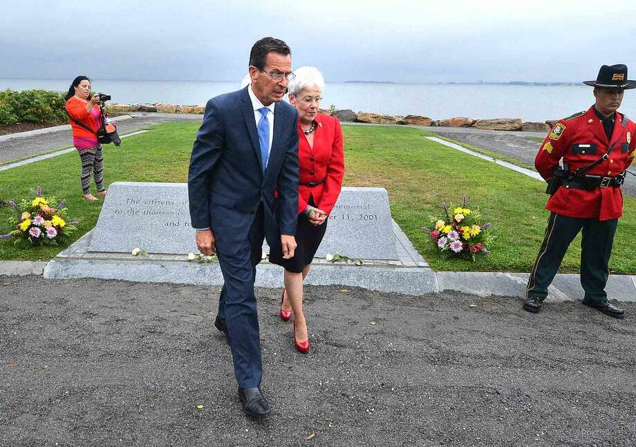 Hour Photo/Alex von Kleydorff Governor Dan malloy and Lt. Governor Nancy Wyman walk from the stone marker after placing a rose on the memorial during the Connecticut Remembers September 11th Memorial Ceremony
