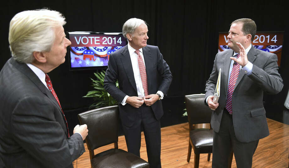 Mark Davis, left, Chief Political Correspondent for WTNH Channel 8, talks with Republican gubernatorial candidates Tom Foley, center, and John McKinney after the Connecticut Governor's Race, Republican Primary Forum at WTNH Channel 8 in New Haven, Conn., Sunday, Aug. 10, 2014. Greenwich businessman Tom Foley and Senate Minority Leader John McKinney made their final pitches to Republican primary voters Sunday, each claiming to have the skills and background to improve Connecticut's economy and defeat Democratic Gov. Dannel P. Malloy in November. (AP Photo/New Haven Register, Arnold Gold)