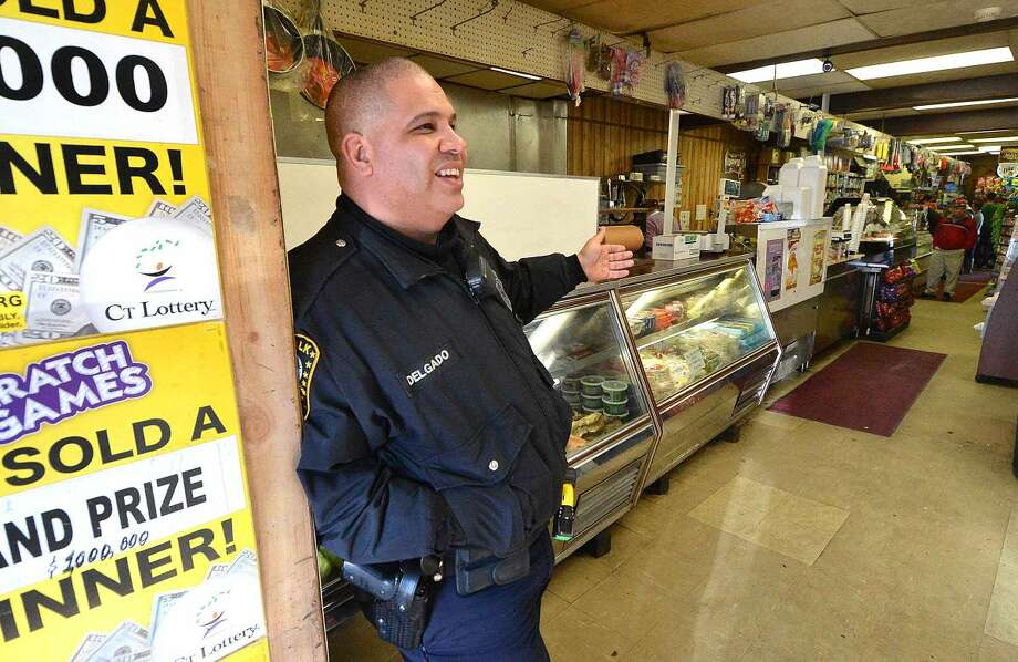 Hour Photo/Alex von KleydorffIn this file photo, Norwalk Police Officer Hector Delgado at C&S Grocery in his old neighborhood