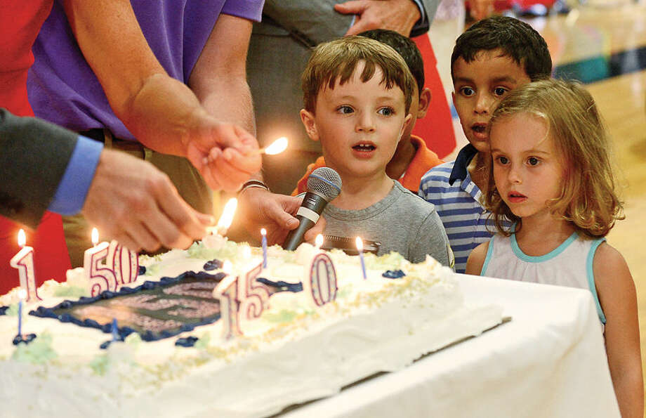 Hour photo / Erik Trautmann Some of the y oungest students at King Low Heywood Thomas School celebrate their 150th anniversary by singing Happy Birthday Thursday during an all-school assembly.