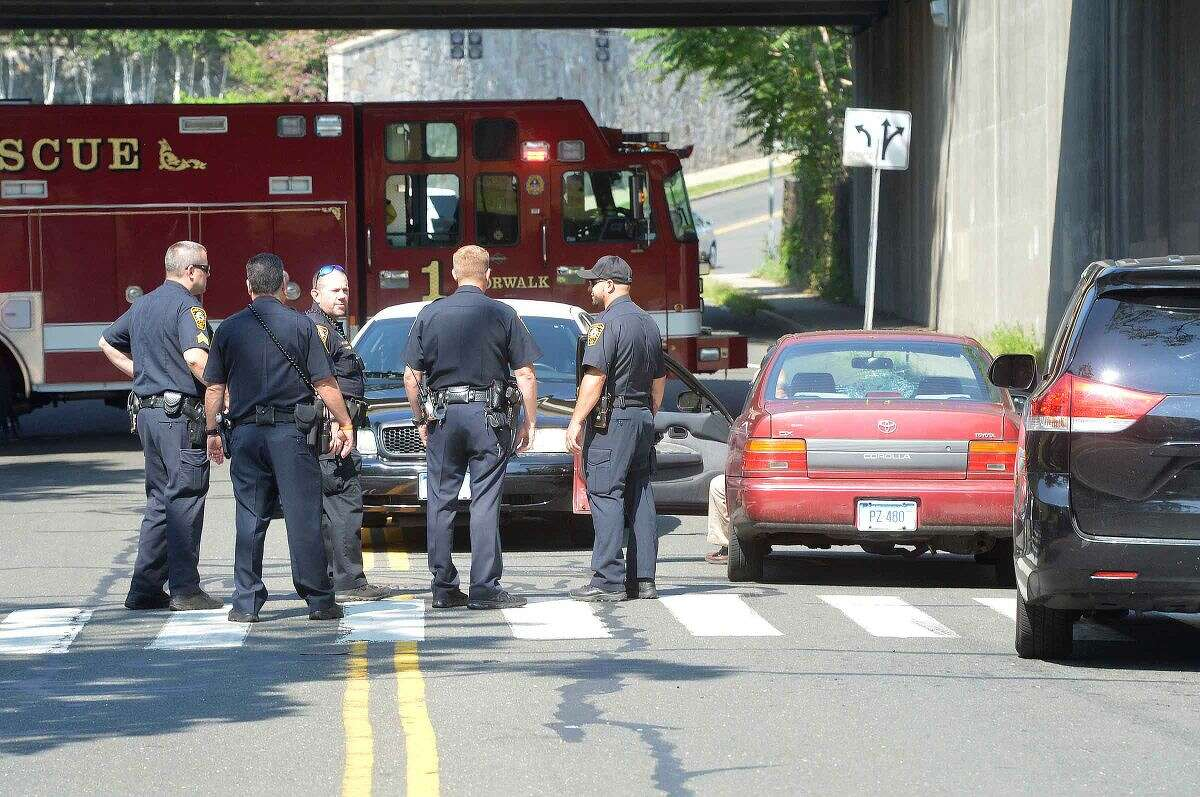 Hour Photo/Alex von Kleydorff Emergency Personel respond to a motor vehicle accident involving a pedestrian at the intersection of Elm and Berkeley St in Norwalk Monday morning