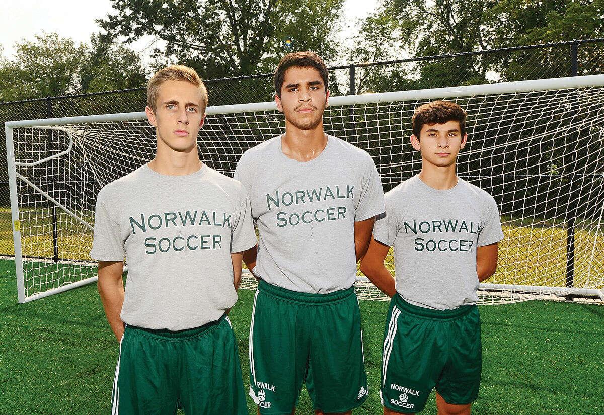 Hour photo / Erik Trautmann Norwalk High School Boys Soccer captains, Tyler Dalton, Lou Karaiskos and George Kutrubis.