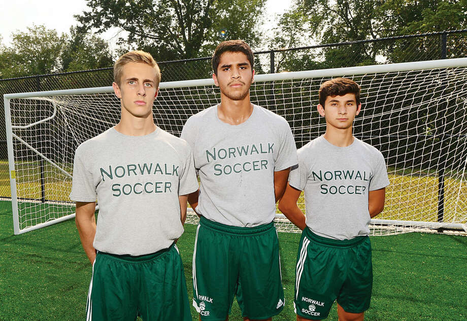 Hour photo / Erik Trautmann Norwalk High School Boys Soccer captains, Tyler Dalton, Lou Karaiskos and George Kutrubis.