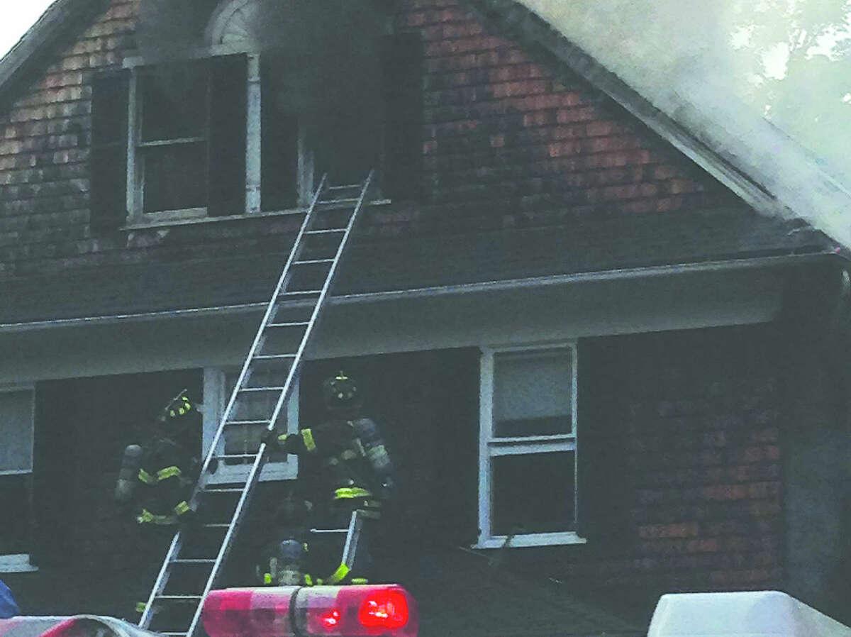 Fire crews battle a blaze on Cannon Street Monday night.