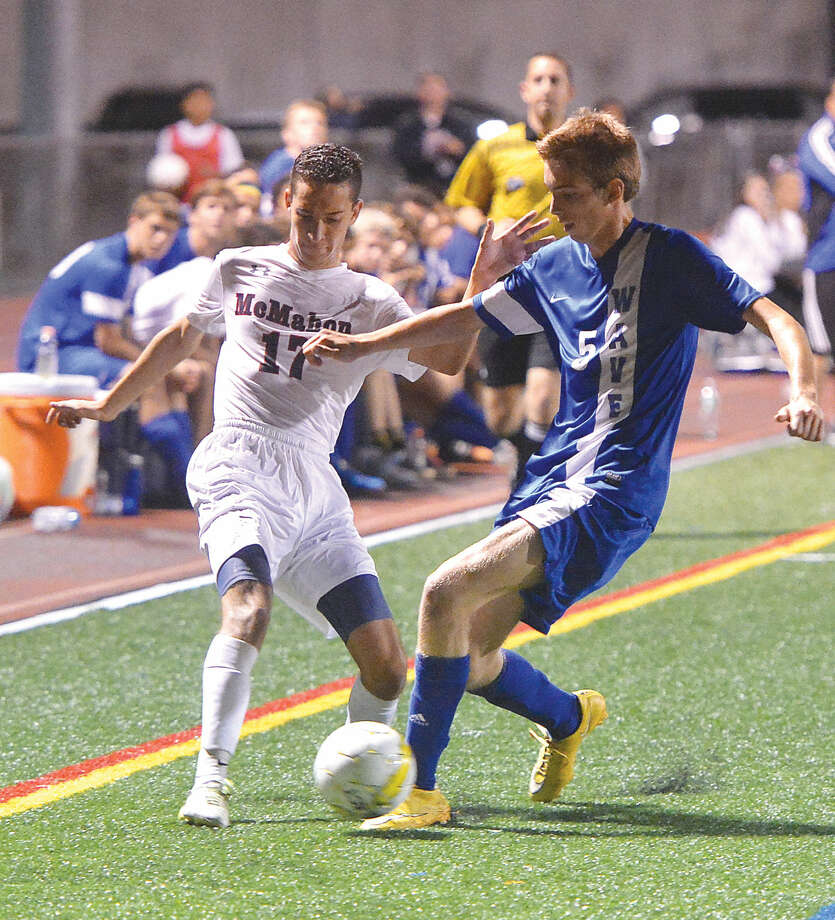 Action from the Brien McMahon vs. Darien boys soccer game on September 11, 2015. Hour Photo/Alex von Kleydorff