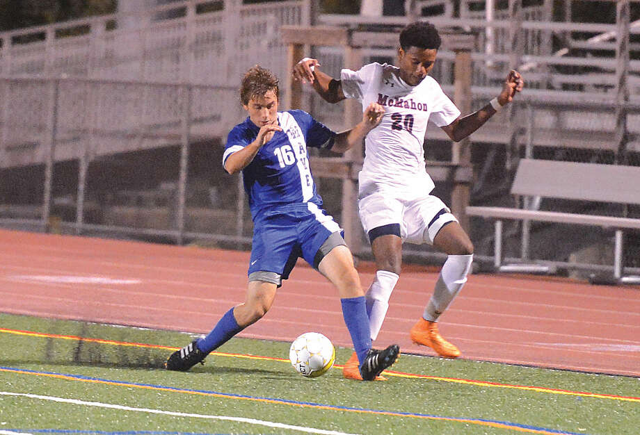 Hour photo/Alex von Kleydorff Brien McMahons Kervens Jean-Charles tries to steal the ball from Darien's Jack Kniffin.