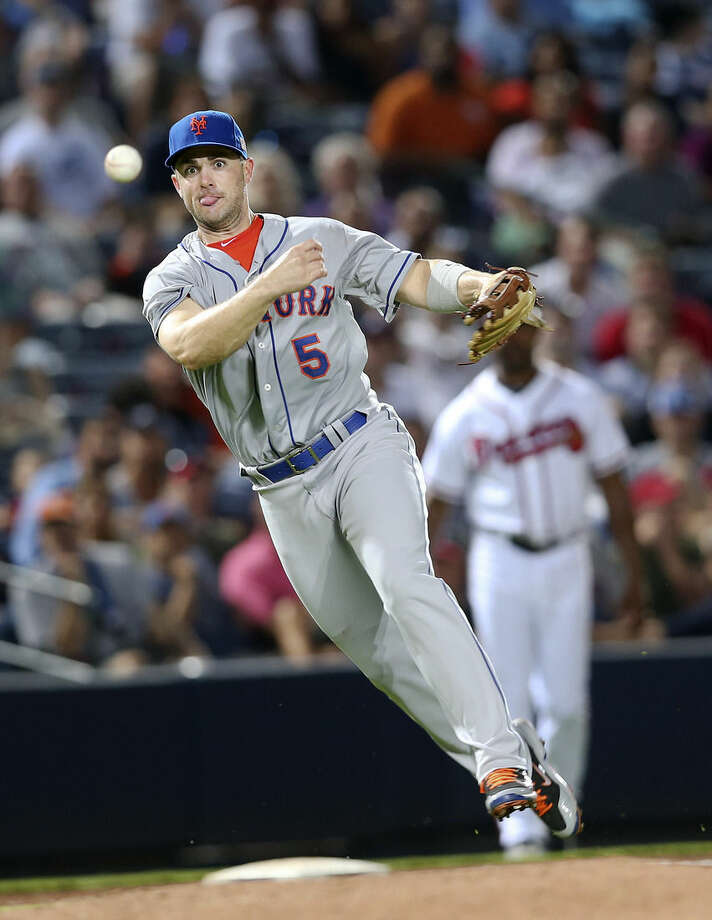 New York Mets third baseman David Wright throws out Atlanta Braves' Nick Swisher after fielding a slow roller during the fifth inning of a baseball game in Atlanta on Friday, Sept. 11, 2015. (AP Photo/John Bazemore)