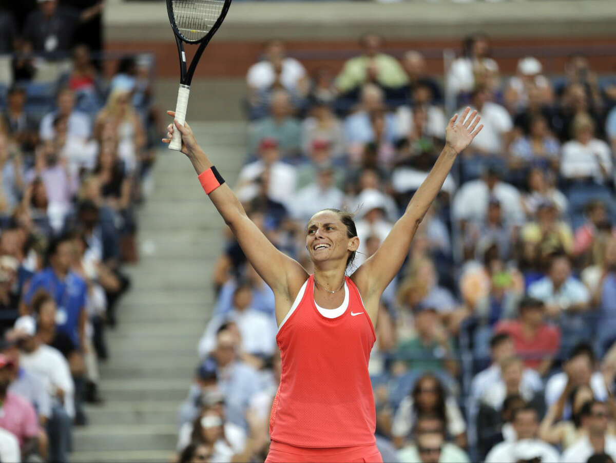 Roberta Vinci, of Italy, reacts after beating Serena Williams in a semifinal match at the U.S. Open tennis tournament, Friday, Sept. 11, 2015, in New York. (AP Photo/David Goldman)