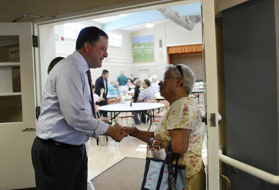 Republican candidate for Connecticut governor John McKinney talks with Connie Razzaia of Fairfield during a visit to the town's senior center, Monday, Aug. 11, 2014, in Fairfield, Conn. McKinney will face Republican Tom Foley in Tuesday's primary. (AP Photo/Jessica Hill)