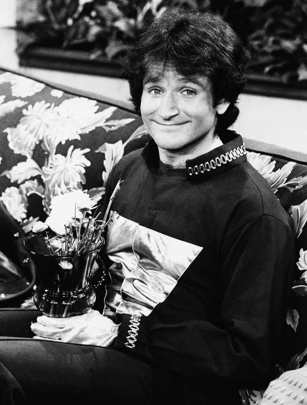 """FILE - This 1978 file photo originally released by ABC shows actor Robin Williams on the set of ABCs """"Mork and Mindy."""" Williams, whose free-form comedy and adept impressions dazzled audiences for decades, has died in an apparent suicide. He was 63. The Marin County Sheriff's Office said Williams was pronounced dead at his home in California on Monday, Aug. 11, 2014. The sheriff's office said a preliminary investigation showed the cause of death to be a suicide due to asphyxia. (AP Photo/ABC, File)"""