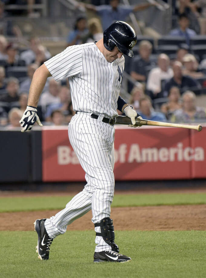 FILE - In this Aug. 17, 2015, file photo, New York Yankees' Mark Teixeira reacts after fouling a ball off his leg during a baseball game against the Minnesota Twins at Yankee Stadium in New York. Teixeira will miss the rest of the season after tests revealed the Yankees first baseman has a fractured right leg. (AP Photo/Bill Kostroun, File)