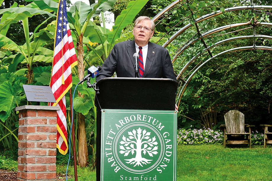 "Hour photo / Erik Trautmann Stamford Mayor David Martin sepaks during the dedication ceremony and unveiling of the ""Arch of 9/11 Remembrance"" at the Bartlett Arboretum & Gardens in Stamford Friday. The archway is comprised of 14 living trees that are offspring of the 9/11 Survivor Tree, a Callery pear that was located on the grounds of the World Trade Center during the 2001 attacks."