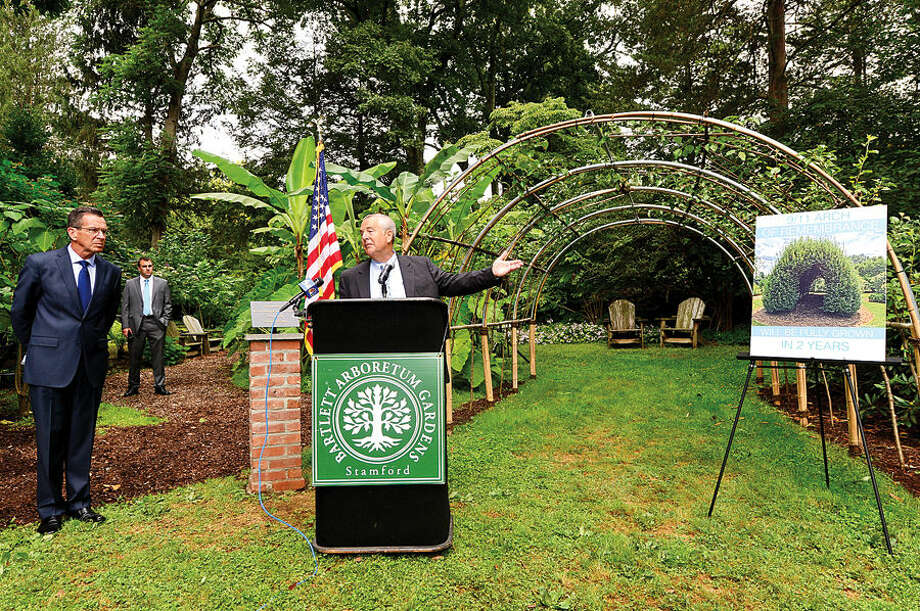 """Hour photo / Erik Trautmann david McMaster, Vice President and Division Manager for Bartlett Tree Experts, introcues Governor Dannel P. Malloy during the dedication ceremony and unveiling of the """"Arch of 9/11 Remembrance"""" at the Bartlett Arboretum & Gardens in Stamford Friday. The archway is comprised of 14 living trees that are offspring of the 9/11 Survivor Tree, a Callery pear that was located on the grounds of the World Trade Center during the 2001 attacks."""