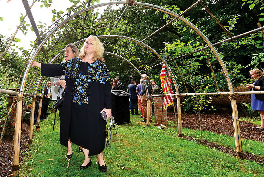 "Hour photo / Erik Trautmann Bartlett Arboretum & Gardens Board of Directors Chair Polly Morrow = attends the dedication ceremony and unveiling of the ""Arch of 9/11 Remembrance"" at the Bartlett Arboretum & Gardens in Stamford Friday. The archway is comprised of 14 living trees that are offspring of the 9/11 Survivor Tree, a Callery pear that was located on the grounds of the World Trade Center during the 2001 attacks."