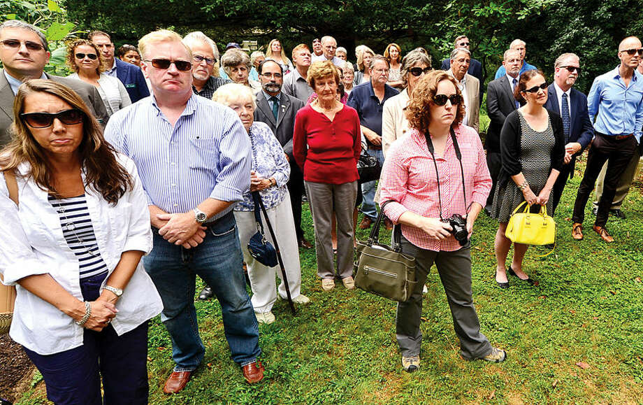 """Hour photo / Erik Trautmann A small crowd as well as local and state dignitaries attend the dedication ceremony and unveiling of the """"Arch of 9/11 Remembrance"""" at the Bartlett Arboretum & Gardens in Stamford Friday. The archway is comprised of 14 living trees that are offspring of the 9/11 Survivor Tree, a Callery pear that was located on the grounds of the World Trade Center during the 2001 attacks."""