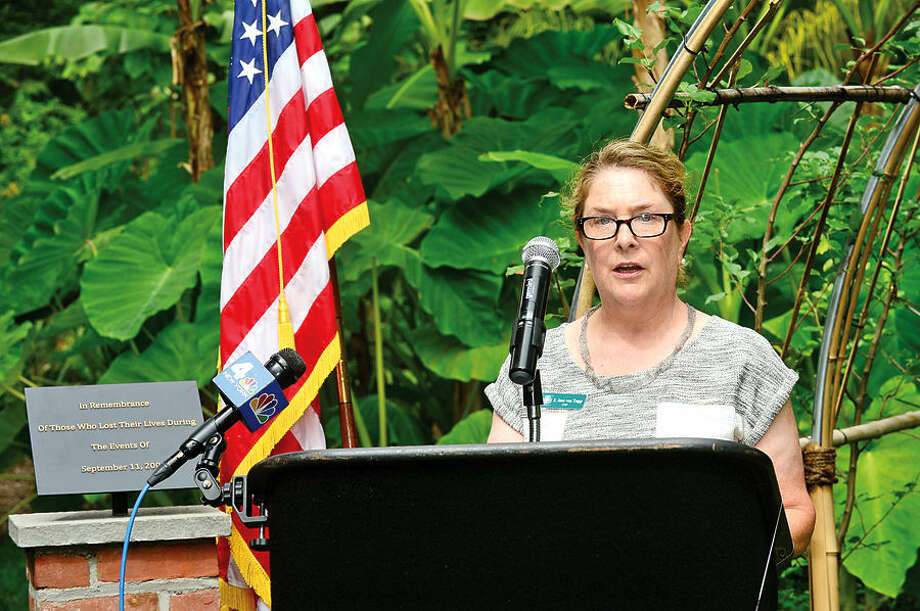 """Hour photo / Erik Trautmann Bartlett Arboretum & Gardens CEO jane Von Trapp speaks during the dedication ceremony and unveiling of the """"Arch of 9/11 Remembrance"""" at the Bartlett Arboretum & Gardens in Stamford Friday. The archway is comprised of 14 living trees that are offspring of the 9/11 Survivor Tree, a Callery pear that was located on the grounds of the World Trade Center during the 2001 attacks."""