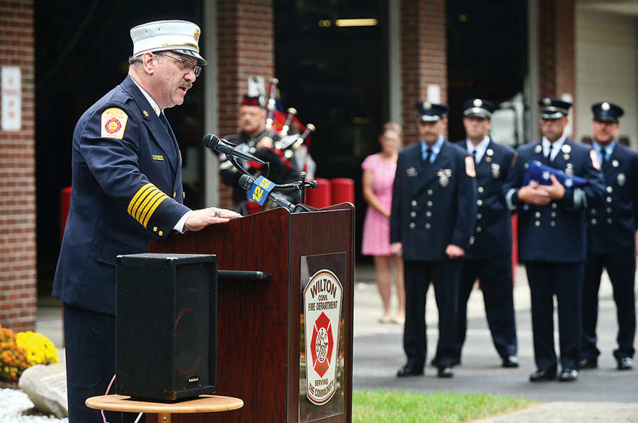Hour photo / Erik Trautmann Wilton Fire Chief Ronald Kanterman addresses the crowd gathered during Wilton's September 11th memorial service Friday at Fire Department Headquarters.