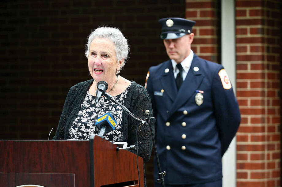 Hour photo / Erik Trautmann Wilton resident Sandy Mumbach speaks of her firefighter sons rescue efforts in New York during Wilton's September 11th memorial service Fridat at Fire Department Headquarters.