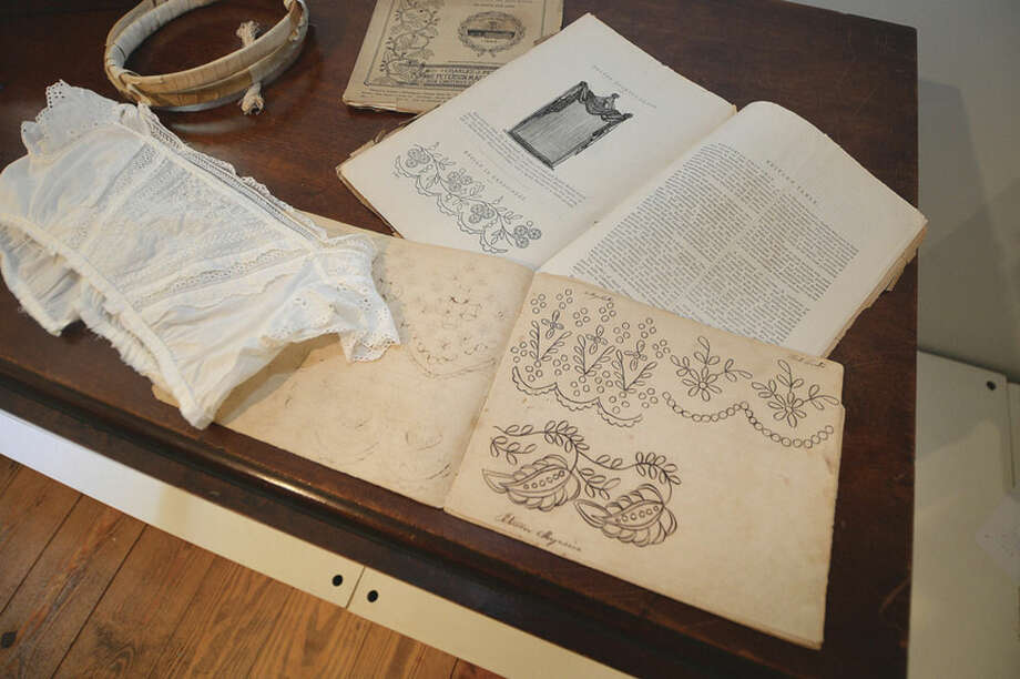 Hour Photo/Alex von Kleydorff Pattern books with the finished piece of clothing are part of the new exhibit White Linen and Lace Baby Clothing 1800-1950