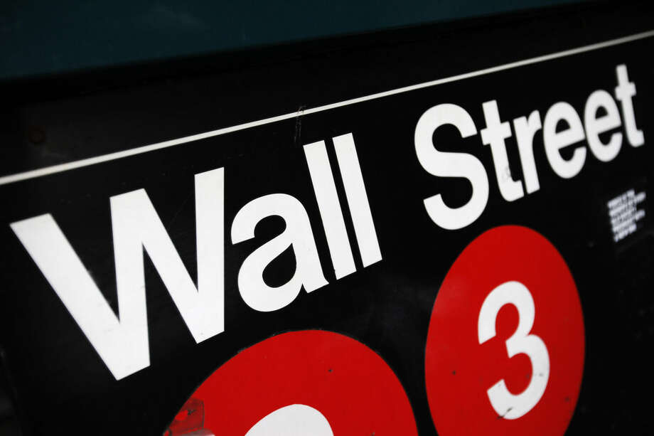 FILE - This Jan. 4, 2010 file photo shows an entrance to a Wall Street subway station in New York. U.S. stocks are edging lower in early trading Monday, Sept. 8, 2014, pulling the market back from a record high close last week. (AP Photo/Mark Lennihan, File)