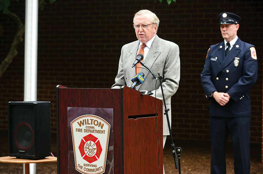 Hour photo / Erik Trautmann Wilton First Selectman Bill Brennan speaks during Wilton's September 11th memorial service Fridat at Fire Department Headquarters.