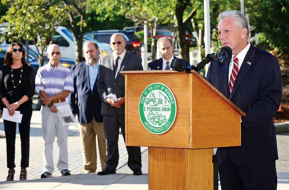 Hour photo / Erik Trautmann Norwalk mayor Harry Rilling greets guest as Norwalk holds their annual 9-11 Remembrance ceremony in the plaza at the front entrance of City Hall Friday.