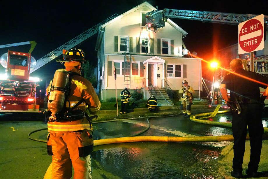 Hour photo/Jeff DaleFire crews battle a 20 Larsen St. blaze Monday night.