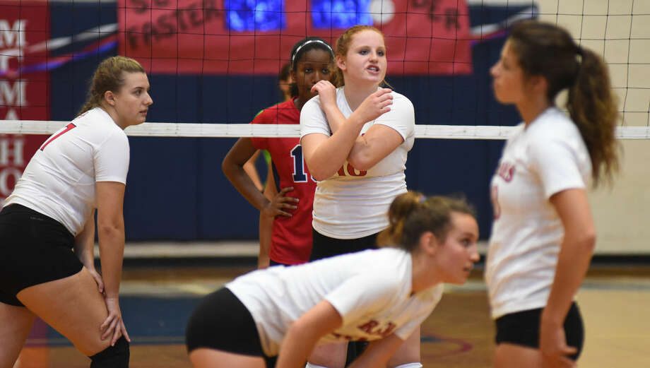 Hour photo/John Nash - Action from Friday's season-opening FCIAC volleyball game between Brien McMahon and New Canaan in Norwalk. The Senators defeated the Rams 3-0.