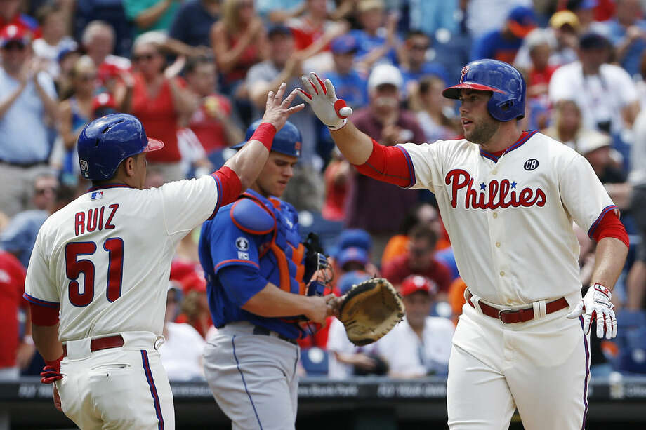 Darin Ruf (right) celebrates after hitting a  home run while playing for the Phillies in 2014. (AP Photo/Matt Slocum)
