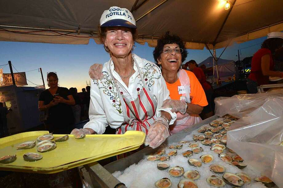 Hour Photo/Alex von Kleydorff Susan Slama and Julie Alter keep the fresh clams cold and ready at the Flotilla 72 tent at Oyster Fest