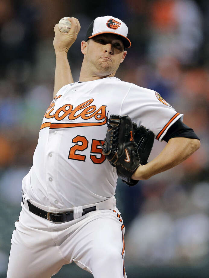 Baltimore Orioles starting pitcher Bud Norris throws to the New York Yankees in the first inning of a baseball game, Monday, Aug. 11, 2014, in Baltimore. (AP Photo/Patrick Semansky)