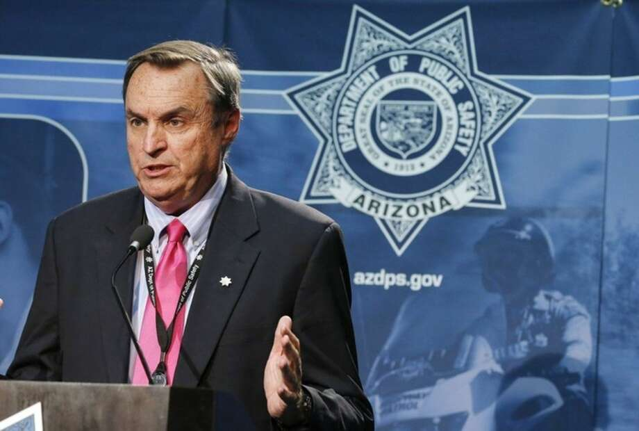 Arizona Department of Public Safety spokesman Bart Graves speaks to the media regarding the latest on police surrounding of a convenience store near Interstate 10, detaining a man and the man's white Chevrolet Tahoe early on Friday, raising hopes of a resolution to the rash of freeway shootings rattling the metro area Sept. 11, 2015, in Phoenix. (AP Photo/Ross D. Franklin)