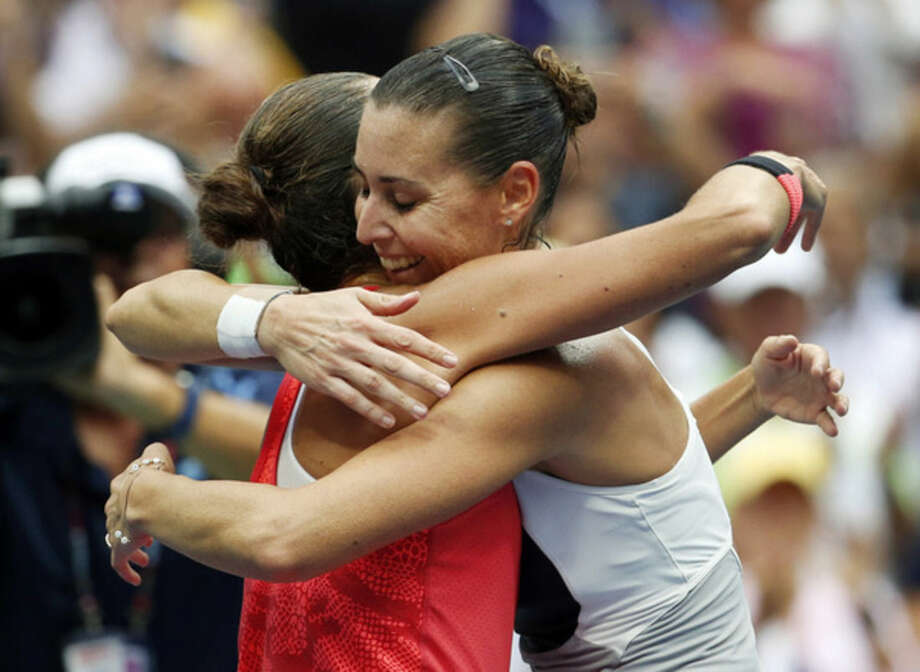 Flavia Pennetta, of Italy, right, hugs Roberta Vinci, of Italy, after winning the women's championship match of the U.S. Open tennis tournament, Saturday, Sept. 12, 2015, in New York. (AP Photo/Julio Cortez)
