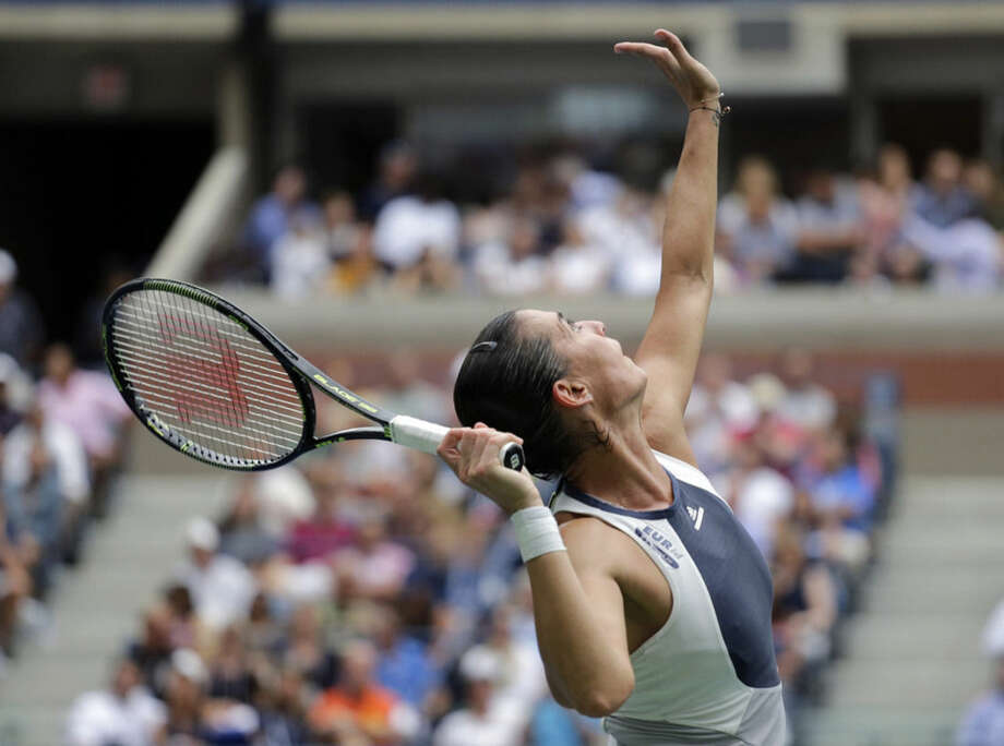 Flavia Pennetta, of Italy, serves to Roberta Vinci, of Italy, during the women's championship match of the U.S. Open tennis tournament, Saturday, Sept. 12, 2015, in New York. (AP Photo/Bill Kostroun)