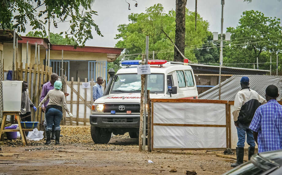 In this photo taken Sunday, Aug. 10, 2014, an ambulance leaves the Ebola isolation unit carrying the bodies of Ebola victims that are highly contagious to a burial site, at the Kenema Government Hospital situated in the Eastern Province around 300 km, (186 miles), from the capital city of Freetown in Kenema, Sierra Leone. Over the decades, Ebola cases have been confirmed in 10 African countries, including Congo where the disease was first reported in 1976. But until this year, Ebola had never come to West Africa. (AP Photo/ Michael Duff)