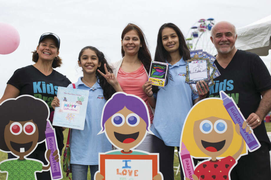 Hour photo/Chris PalermoLisette Perez, Himani Narayan, Prachi Narayan, Sushmita Narayan, and Alex Virvo pose at the Kids Draw Free booth at the Oyster Festival Saturday afternoon.