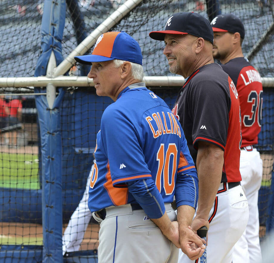 New York Mets manager Terry Collins, left, and Atlanta Braves manager Fredi Gonzalez watch batting practice before a baseball game, Saturday, Sept. 12, 2015, in Atlanta. (AP Photo/Jon Barash)