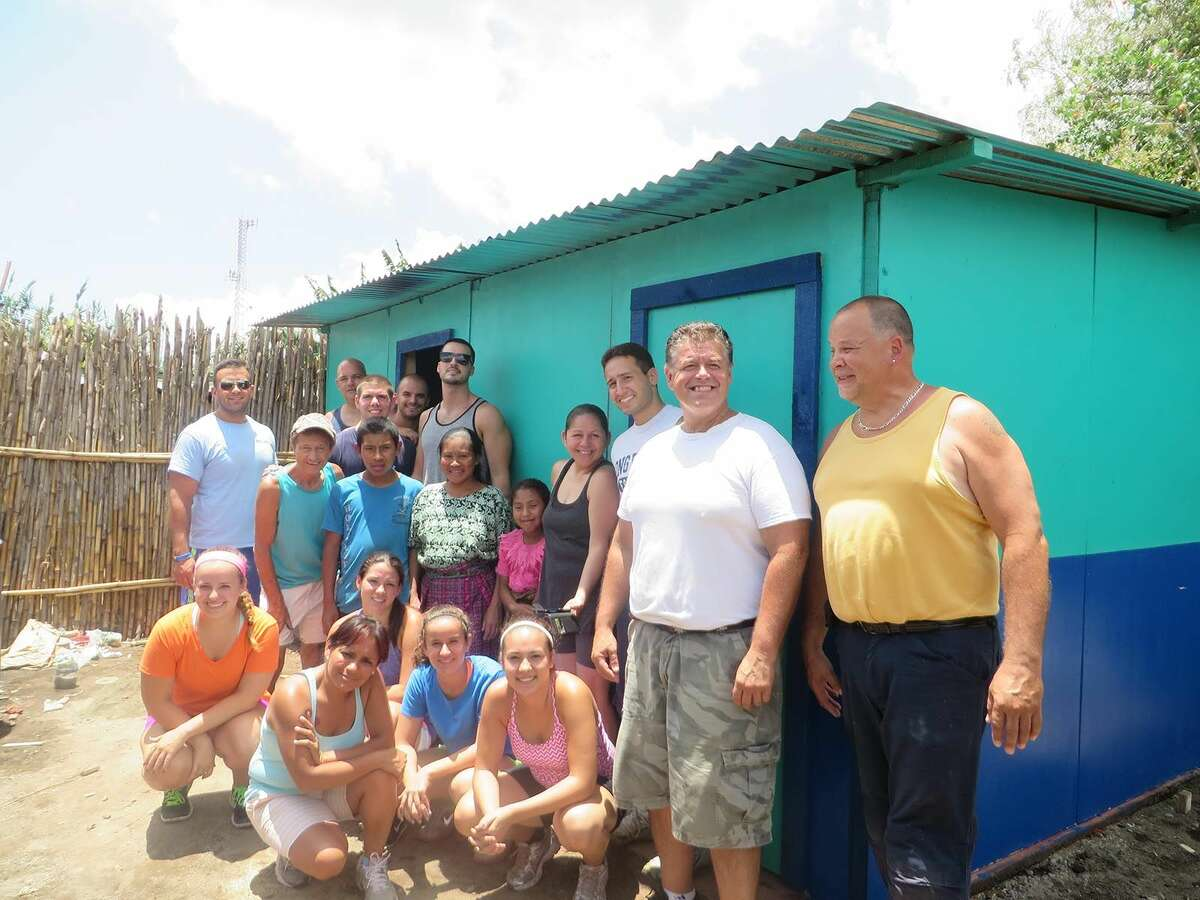 Contributed photo Rev. Artie Kassimis of Word Alive Bible Church (white shirt in the middle) and his team who helped build a home for a family in Guatemala.