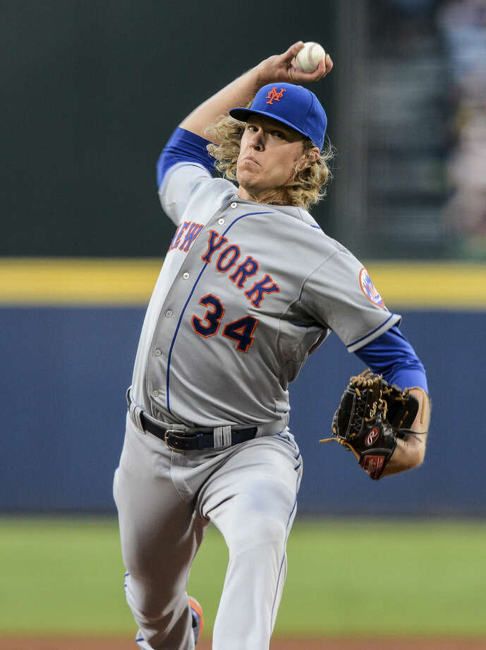 New York Mets starting pitcher Noah Syndergaard (34) works during the first inning of a baseball game against the Atlanta Braves, Saturday, Sept. 12, 2015, in Atlanta. (AP Photo/Jon Barash)