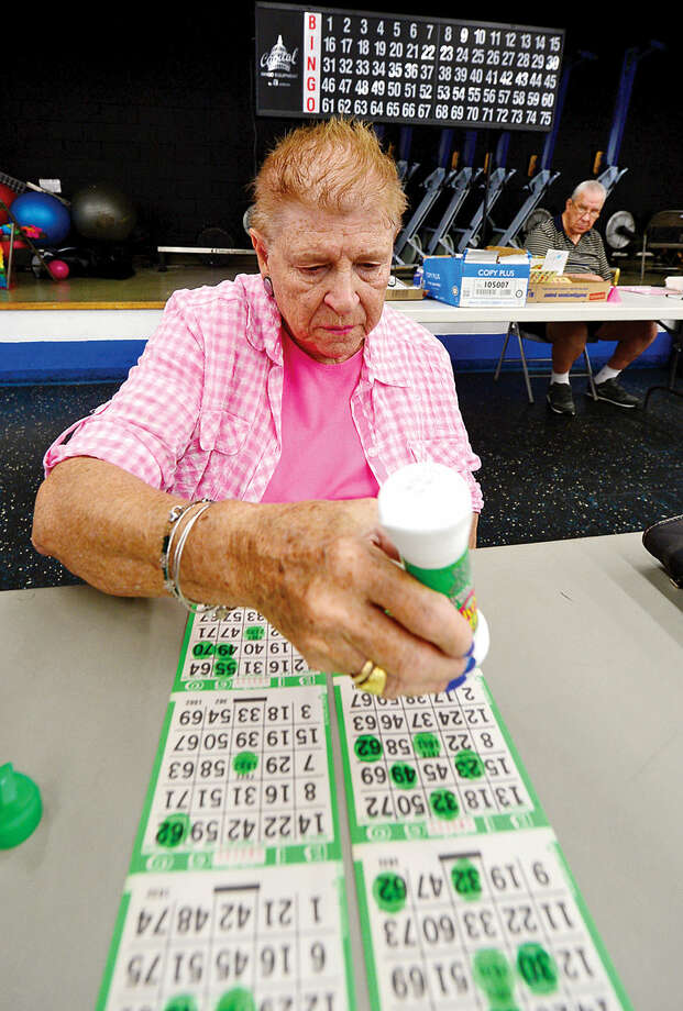 Hour photo / Erik Trautmann Mary Bogdany plays Bingo at the Norwalk Senior Center on Allen Rd Thursday. The Senior Center will be holding new nighttime Bingo scheduled for Thursday nights premeiring Thursday, September 17th from 6:30pm to 9:30.