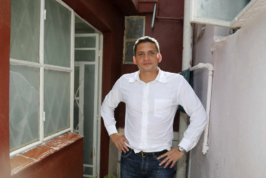 """In this June 30, 2015, file photo, dissident Eliecer Avila, head of the opposition group Somos Mas, stands at the entrance of his home in Havana, Cuba. """"It's essential that the pope delivers a message to the government of Cuba,"""" Avila said. (AP Photo/Desmond Boylan, File)"""