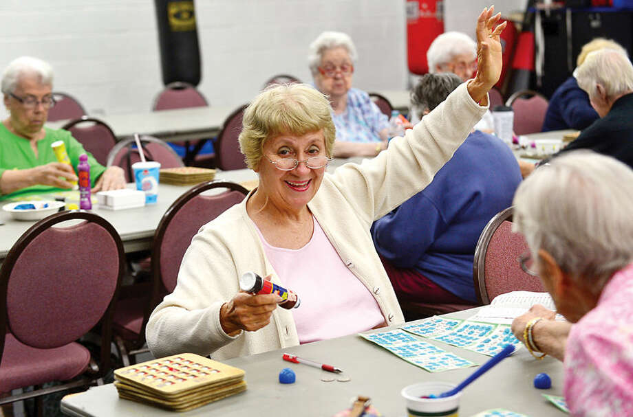 Hour photo / Erik Trautmann Baetty Ann Obringer signals Bingo at the Norwalk Senior Center on Allen Rd Thursday. The Senior Center will be holding new nighttime Bingo scheduled for Thursday nights premeiring Thursday, September 17th from 6:30pm to 9:30.