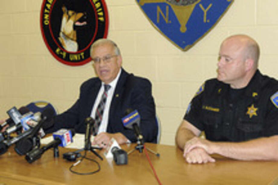 Ontario County Sheriff Philip Povero, left, at a news conference Sunday Aug. 10, 2014, in Canandaigua , N.Y., says that investigators don't have any evidence at this point to support criminal intent in the fatal crash that killed Kevin Ward Jr., and involved racing superstar Tony Stewart. At right is Sergeant James Alexander. (AP Photo/The Daily Messenger, Melody Burri)