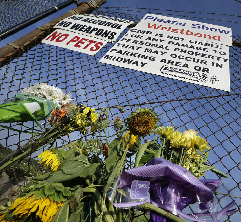 "A small memorial of flowers is seen at Canandaigua Motorsports Park Monday, Aug. 11, 2014, in Canandaigua, N.Y. On Saturday night, Tony Stewart struck and killed Kevin Ward Jr., 20, a sprint car driver who had climbed from his car and was on the track trying to confront Stewart during a race at the track in upstate New York. Ontario County Sheriff Philip Povero said his department's investigation is not criminal and that Stewart was ""fully cooperative"" and appeared ""very upset"" over what had happened. (AP Photo/Mel Evans)"