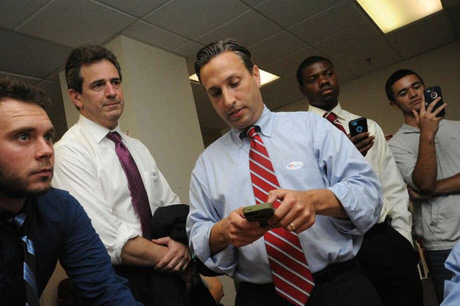 Chris Perone and State Senator Bob Duff Tuesday night wait for election results. Hour photo/Matthew Vinci