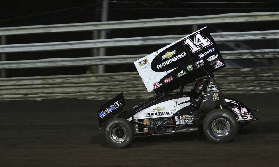 FILE - In this Aug. 5, 2013, file photo, three-time NASCAR champion Tony Stewart races at Southern Iowa Speedway in Oskaloosa, Iowa. Stewart broke his leg in the race. Stewart's hobby, racing on tiny little tracks in nondescript towns outside of a busy NASCAR schedule, is again being called into question. (AP Photo/The Des Moines Register, Mary Willie, File) NO SALES