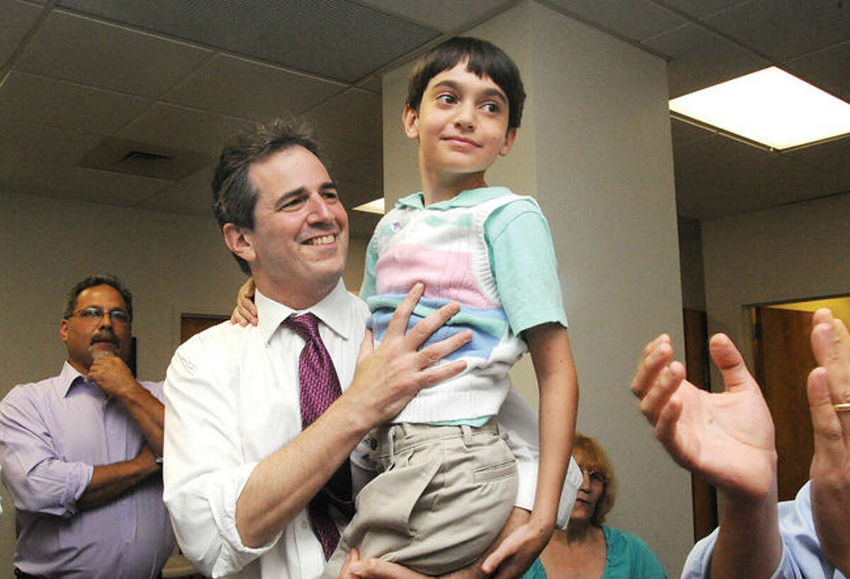 Chris Perone celebrates his primary win Tuesday in Norwalk for State Representative with his son Harrison, 9. Hour photo/Matthew vinci