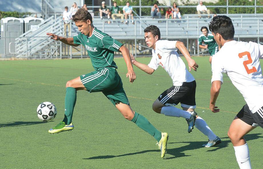 Hour Photo/Alex von Kleydorff Norwalks #19 Santiago Mesa controls the ball vs Stamford