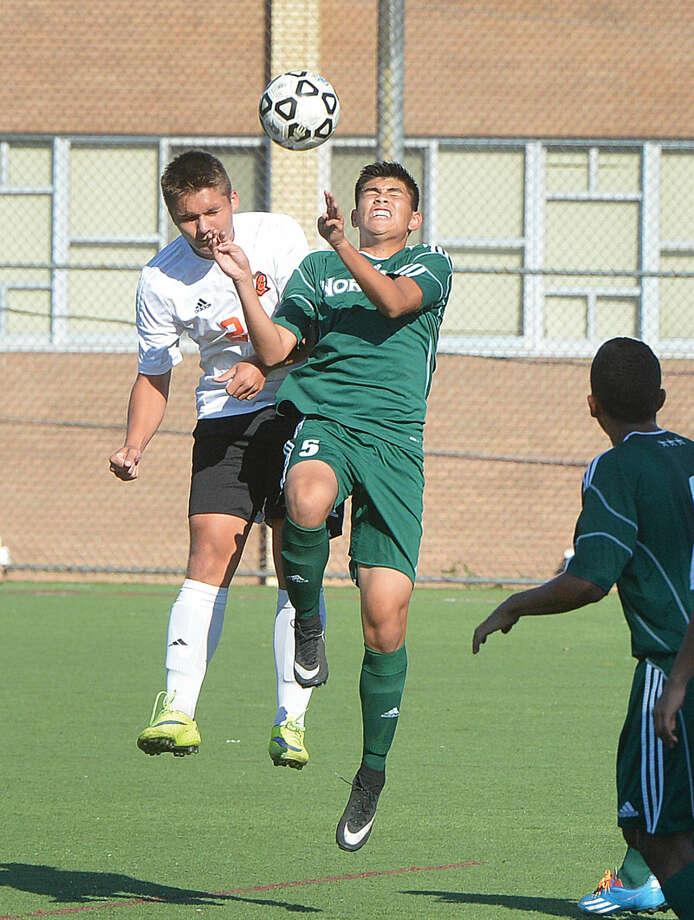 Hour Photo/Alex von Kleydorff Norwalks #5 Fredy Rosales goes for the ball vs Stamford