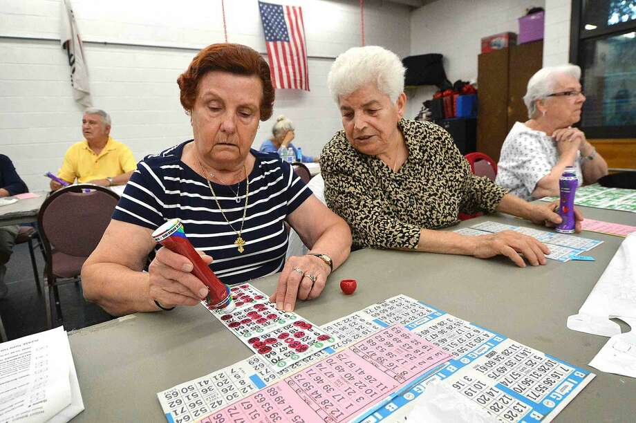Hour Photo/Alex von Kleydorff Glika Hios and Gieuseppa Sforza check numbers during the first of the Thursday Night Bingo nights at The Norwalk senior Center
